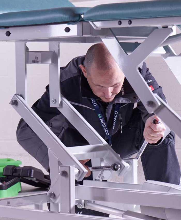 An adjustable bed being serviced